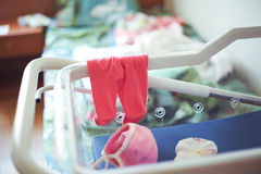 Panties and little baby cap in hospital cradle for newborns Royalty Free Stock Photo