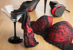 Panties in a martini glass on the background of  shoes and  bra Royalty Free Stock Photo