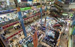 Pantip Plaza. BANGKOK - JANUARY 14. Crowds at Pantip Plaza shopping centre on January 14, 2012 in Bangkok, Thailand. The plaza is a mekka for all things Royalty Free Stock Photo