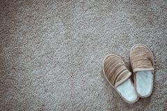 Pantoffel auf der Matte, Draufsicht Stockbilder