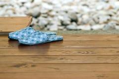 Pantoffels op buitendek Stock Foto