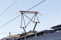 Pantograph on the old train on a background of the sky. Russia Stock Photography