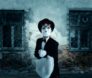Pantomime actor in glasses shows boxer. Mime in suit, gloves and hat. April fools day concept Royalty Free Stock Images
