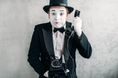 Pantomime actor performing with retro telephone royalty free stock images