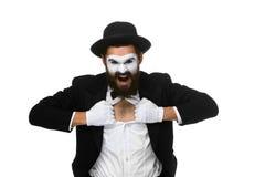 Pantomime als Geschäftsmann, der sein Hemd auseinander reißt Stockbild