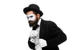 Pantomime comme homme d'affaires mettant l'argent dans sa poche Images libres de droits