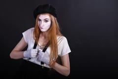 Pantomime Girl dans des bretelles Photos stock