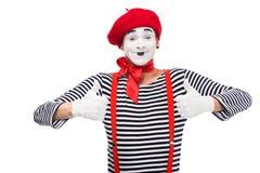 Pantomime heureux montrant des pouces  image libre de droits
