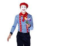 Pantomime mit Blume Emotionales lustiges Schauspielertragen Stockfotos