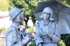 Pantomime pair in Bellagio, at Lake Como, Italy. Pantomime pair, looks like a Statue in Bellagio at lake Como, Italy stock photo