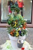 Pantomime streetart at Freiburg, Breisgau, Black Forest Germany. Pantomime streetart, looks like a flower pott, at Freiburg, Breisgau, Black Forest Germany Royalty Free Stock Images