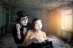 Pantomime theater actor and actress performing. Mime artists with white makeup masks on faces royalty free stock images