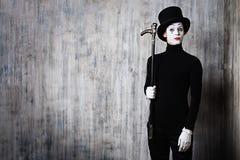 Pantomime und ein Stock Stockbild