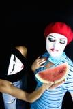 Pantomimen und eine Wassermelone Lizenzfreie Stockbilder