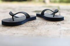 Pantoufles sur le plancher, version 2 photos stock