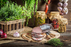 Pantry with mortars, smoked ham and herbs Stock Image