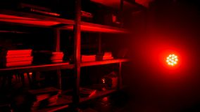 Pantry or storeroom with red lamp and light. Red light bulb glowing from fixture in dark room. Red Vintage Room. Background HD stock photography