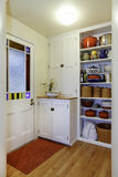 Pantry view with storage shelves in Small hallway. Exit to backyard area, Northwest, USA stock photography