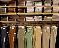 Pants display on shelf. In fashion store stock photos