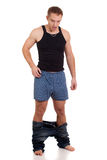 Pants Down. Man with pants down. Studio shot over white Royalty Free Stock Photo