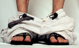 Pants down on sandals. Shot of pants down on sandals Stock Photos