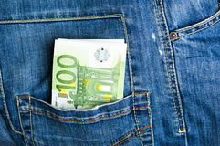 Pants jeans with euro banknotes in the pocket Royalty Free Stock Photography