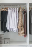Pants, shirts and dress hanging Royalty Free Stock Photo