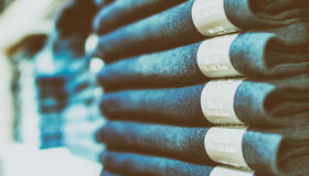 Pants stacked in a shop.  Royalty Free Stock Photos