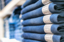 Pants stacked in a shop.  Stock Photo