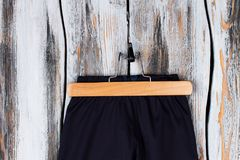 Pants on a wooden hanger Royalty Free Stock Photography