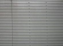 Panwiowa metal ściana, szczegół ściana wykładał z metalem, błyszcząca stal fotografia royalty free