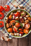 Panzanella salad close-up on a plate. vertical top view Royalty Free Stock Images