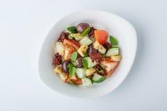 Panzanella salad with sun-dried tomatoes and ciabatta in a ceram Stock Photo