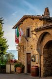 Panzano, Italy - August 19, 2018: Entrance to the colorful restaurant in Panzano with hanging flags stock photography