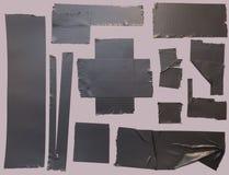 Panzerklebebandstücke lizenzfreies stockfoto