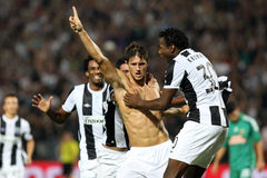 PAOK against Rapid football match. THESSALONIKI,GREECE-AUG 23:PAOK Katsikas (C) celebrates after scoring a goal against Rapid during the UEFA Europa League Stock Photo