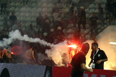 PAOK against Rapid football match riots. THESSALONIKI, GREECE-AUG 23:Clashes PAOK Thessaloniki and Rapid Vienna fans and the police before UEFA Europe League Royalty Free Stock Photo