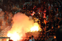 PAOK against Rapid football match riots. THESSALONIKI, GREECE-AUG 23:Clashes PAOK Thessaloniki and Rapid Vienna fans and the police before UEFA Europe League Stock Image