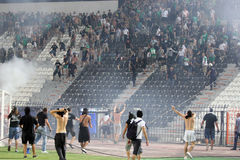 PAOK against Rapid football match riots. THESSALONIKI, GREECE-AUG 23:Clashes PAOK Thessaloniki and Rapid Vienna fans and the police before UEFA Europe League Stock Photography