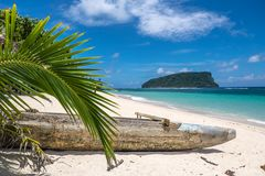 Paopao - traditional Samoan wooden timber kayak on Lalomanu Beach, Upolu Island, Samoa, South Pacific. Paopao - traditional Samoan wooden timber kayak on the royalty free stock photography