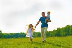Papà con i bambini Immagini Stock