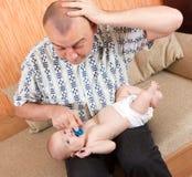 Papá con el bebé Imagen de archivo libre de regalías
