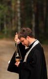 Papá durante la adoración Imagenes de archivo