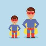 Papá e hijo vestidos como super héroe Imagen de archivo libre de regalías
