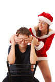 Papá Noel bonito que juega con el muchacho. Imagenes de archivo