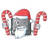 Papá Noel con el botón del alt de la historieta del caramelo en la tabla ilustración del vector