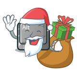 Papá Noel con el botón del alt de la historieta del regalo en la tabla ilustración del vector