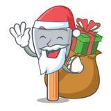 Papá Noel con el cuchillo de masilla del vintage del regalo en mascota ilustración del vector