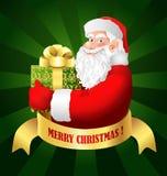 Papá Noel con el rectángulo de regalo Fotos de archivo libres de regalías