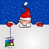 Papá Noel con el regalo Imagenes de archivo